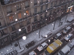 Snow falling outside our hotel window, day 5 in Paris