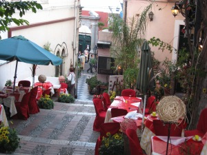 Colourful bistro cascading down a Taormina sidestreet