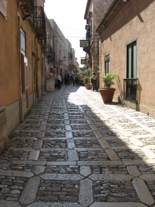 Paved streets, polished by the passing parade of pedestrians, Erice, Sicily